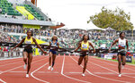 Jamaica's Elaine Thompson-Herah, left, wins the 100 meters, as American track and field sprinter Sha'carri Richardson, second from left, also competes, Saturday, Aug. 21, 2021, at the Prefontaine Classic track and field meet in Eugene, Ore. Richardson finished in last place. (AP Photo/Thomas Boyd)