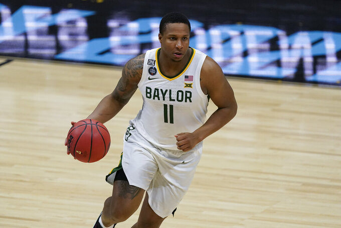 Baylor guard Mark Vital drives up court during the second half of a men's Final Four NCAA college basketball tournament semifinal game against Houston, Saturday, April 3, 2021, at Lucas Oil Stadium in Indianapolis. (AP Photo/Darron Cummings)