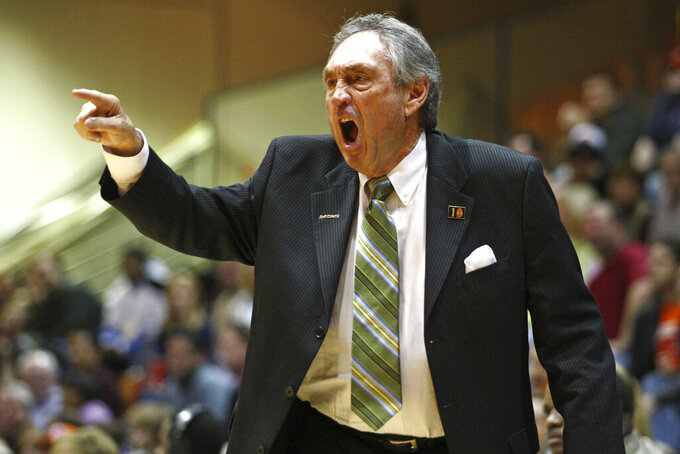 FILE - In this Saturday, Feb. 2, 2008, file photo, San Francisco head coach Eddie Sutton coaches against Pepperdine during the second half of an NCAA college basketball game in Malibu, Calif. USF won 88-85 to give Sutton his 800th win. Sutton, the Hall of Fame basketball coach who led three teams to the Final Four and was the first coach to take four schools to the NCAA Tournament, died Saturday, May 23, 2020. He was 84. (AP Photo/Jeff Lewis, File)