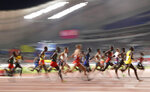 Competitors race in the men's 10,000 meter final at the World Athletics Championships in Doha, Qatar, Sunday, Oct. 6, 2019. (AP Photo/Petr David Josek)