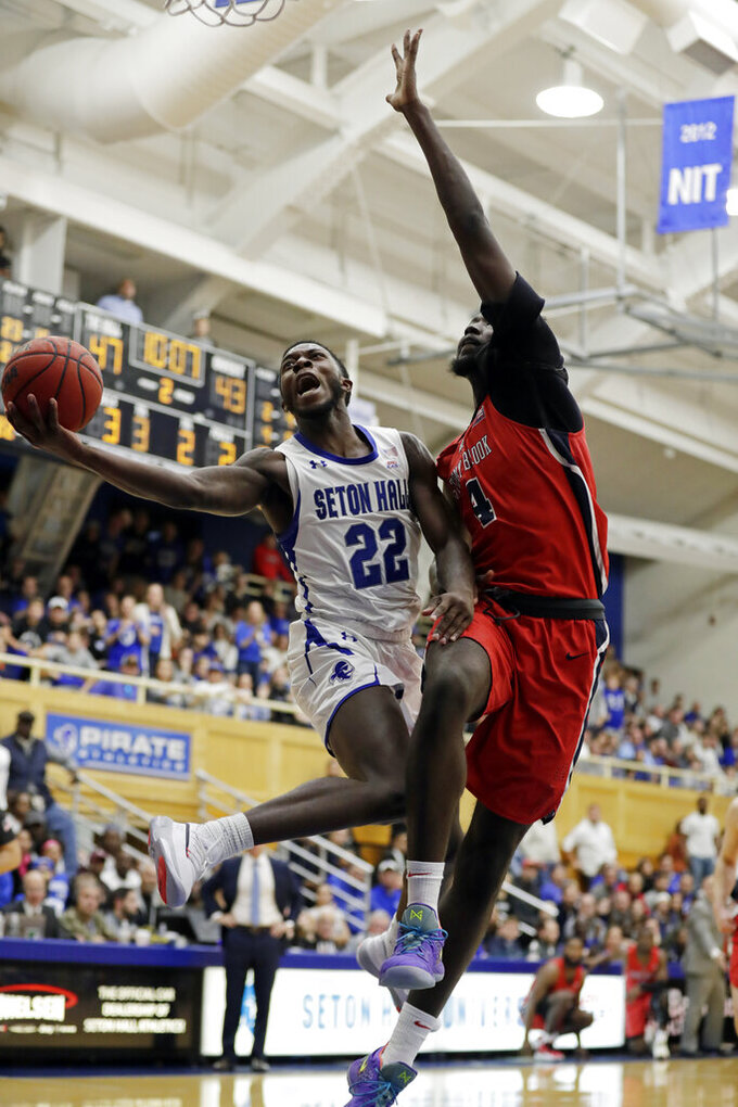 Seton Hall guard Myles Cale (22) drives to the basket past Stony Brook center Jeff Otchere (4) during the second half of an NCAA college basketball game, Saturday, Nov. 9, 2019, in South Orange, N.J. Seton Hall won 74-57. (AP Photo/Adam Hunger)