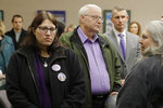 Chuck Cox, center, and his wife, Judy Cox, right, stand with their daughter, Denise Ernest, left, and their attorney, Ted Buck, second from right, Tuesday, Feb. 18, 2020, during a break in a session of Pierce County Superior Court in Tacoma, Wash., on the first day of a civil lawsuit over the murder of the Cox's young grandsons. Chuck and Judy are the parents of missing Utah woman Susan Cox Powell and the grandparents of Susan's sons Charlie and Braden, who were attacked and killed by their father Josh Powell in 2012 while he was under suspicion for Susan Powell's disappearance. The Coxes allege that negligence by the Washington state Department of Social and Health Services was a contributing factor that led to the deaths of their grandsons. (AP Photo/Ted S. Warren)