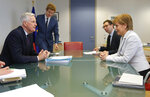 European Union chief Brexit negotiator Michel Barnier, left, speaks with Scotland's First Minister Nicola Sturgeon during a meeting at EU headquarters in Brussels Tuesday, June 11, 2019. (Olivier Hoslet, Pool Photo via AP)