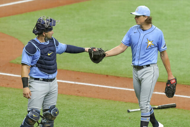 Tampa Bay Rays' Tyler Glasnow, right, bumps fists with catcher Mike Zunino after pitching during baseball practice Tuesday, July 14, 2020, in St. Petersburg, Fla. (AP Photo/Mike Carlson)