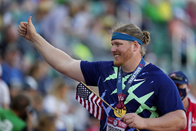 Ryan Crouser celebrates during a victory lap, after setting a world record during the finals of men's shot put at the U.S. Olympic Track and Field Trials Friday, June 18, 2021, in Eugene, Ore. (AP Photo/Ashley Landis)