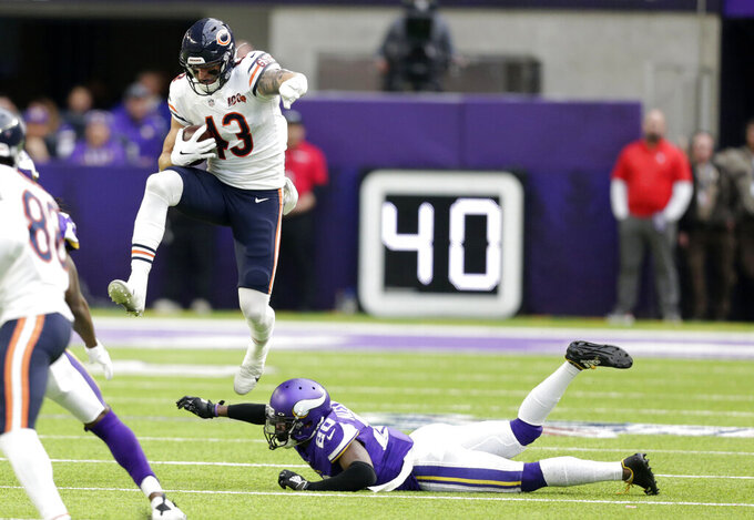 Chicago Bears tight end Eric Saubert (43) leaps over Minnesota Vikings cornerback Mackensie Alexander, right, during the first half of an NFL football game, Sunday, Dec. 29, 2019, in Minneapolis. (AP Photo/Andy Clayton-King)