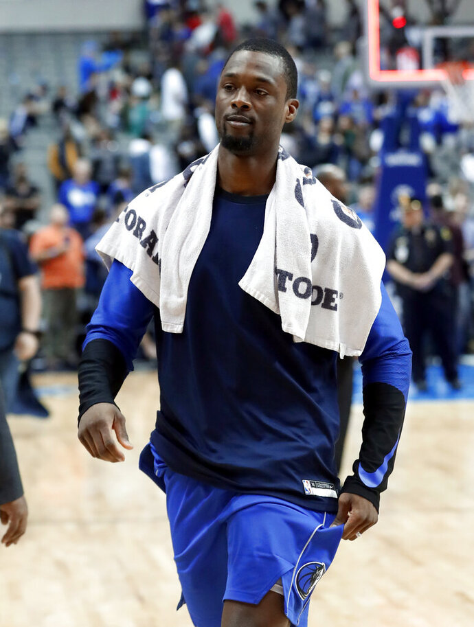 Dallas Mavericks' Harrison Barnes walks off the court after the team's NBA basketball game against the Charlotte Hornets in Dallas, Wednesday, Feb. 6, 2019. Barnes was traded during the game to the Sacramento Kings for Zach Randolph and Justin Jackson. (AP Photo/Tony Gutierrez)