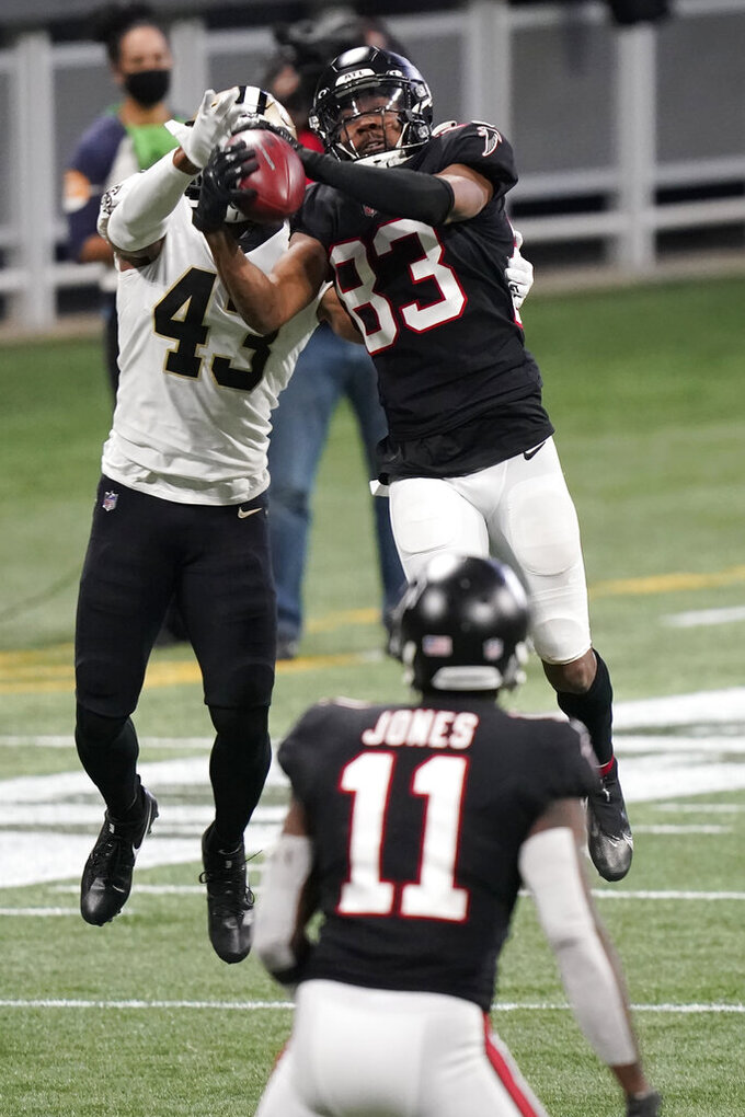Atlanta Falcons wide receiver Russell Gage (83) makes the catch against New Orleans Saints free safety Marcus Williams (43) during the second half of an NFL football game, Sunday, Dec. 6, 2020, in Atlanta. (AP Photo/Brynn Anderson)