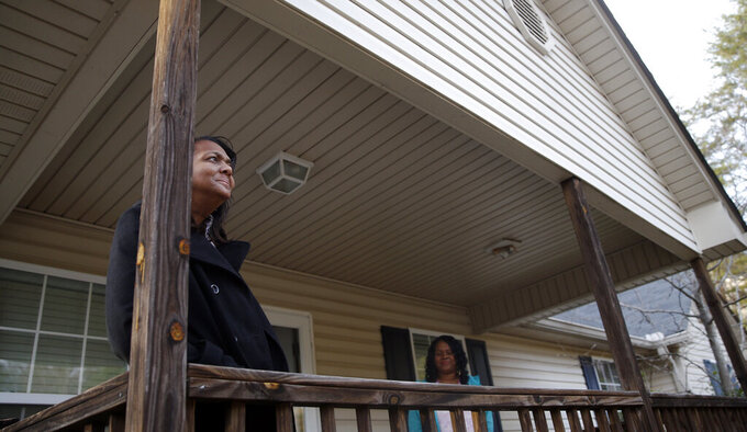 FILE - In this  Jan. 6, 2016, file photo, Deann Watson, mother of Clemson quarterback Deshaun Watson, poses portrait on the front porch of her home in Gainesvilles, Ga. Deshaun Watson's mother spent years encouraging him to chase his dreams. He has achieved one of his biggest goals of reaching the NFL. Now the Houston Texans quarterback is giving back by renovating the home he grew up in and surprising his mom.  (AP Photo/John Bazemore, File)