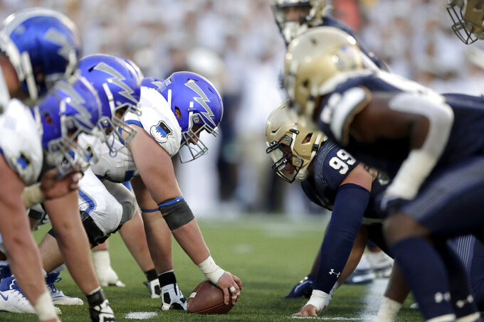 The Air Force offense, left, lines up against the Navy defense during the second half of an NCAA college football game Saturday, Oct. 5, 2019, in Annapolis, Md. Navy won 34-25. (AP Photo/Julio Cortez)