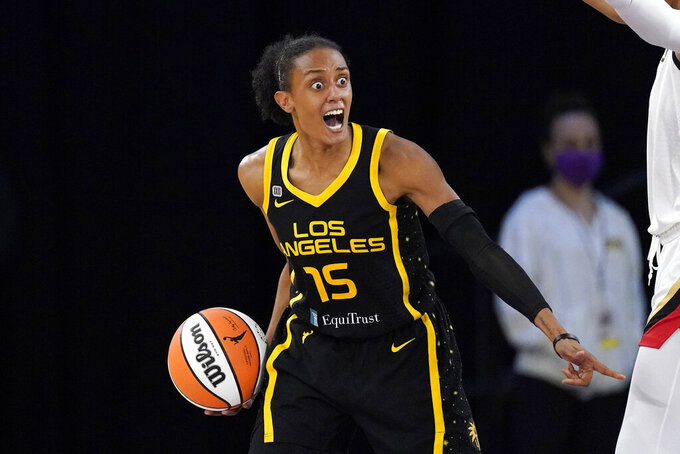 Los Angeles Sparks guard Brittney Sykes reacts after committing a shot clock violation during the second half of a WNBA basketball game against the Las Vegas Aces Friday, July 2, 2021, in Los Angeles. The Aces won 66-58. (AP Photo/Mark J. Terrill)