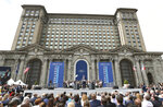 FILE - In this June 19, 2018, file photo, Ford Motor Co., Executive Chairman Bill Ford addresses attendees outside the Michigan Central train depot, in Detroit. Restoration work has continued at the train station following a state-mandated stay-at-home order to stem the spread of the COVID-19 virus. The Detroit Free Press reports that crews are in the middle of Phase Two of the project which involves fixing the street structure and repairing masonry.   (AP Photo/Carlos Osorio File)