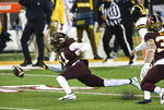 Minnesota defensive back Michael Dixon (11) attempts to recover a blocked punt in the first half of an NCAA college football game Saturday, Oct. 24, 2020, in Minneapolis, Minn.  (Aaron Lavinsky/Star Tribune via AP)
