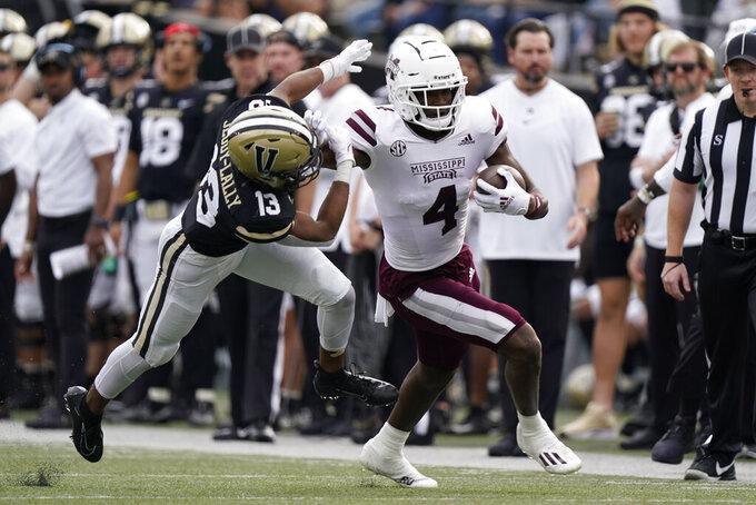 Mississippi State wide receiver Malik Heath (4) pushes Vanderbilt cornerback Gabe Jeudy-Lally (13) away in the first half of an NCAA college football game Saturday, Oct. 23, 2021, in Nashville, Tenn. (AP Photo/Mark Humphrey)