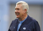 FILE - In this March 3, 2019 file photo, North Carolina coach Mack Brown smiles during the NCAA college football team's first practice of the season in Chapel Hill, N.C. Brown is back for a second stint at North Carolina after more than two decades away. He led the Tar Heels to consecutive top-10 finishes in 1996 and '97 before moving to Texas, then spending the past few years in broadcasting.  (Ethan Hyman/The News & Observer via AP, File)