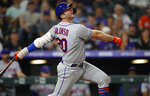 New York Mets' Pete Alonso watches his RBI single of Colorado Rockies pitcher Wes Parsons during the eighth inning of a baseball game Tuesday, Sept. 17, 2019, in Denver. (AP Photo/David Zalubowski)