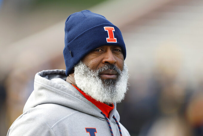 FILE - In this Nov. 23, 2019, file photo, Illinois head coach Lovie Smith walks on the field before an NCAA college football game against Iowa, in Iowa City, Iowa. Even after beating a Wisconsin team that was favored by 30 ½ points last year, Illinois heads into Madison as a 19 ½-point underdog as the two West Division rivals prepare to open the pandemic-delayed Big Ten season Friday night. (AP Photo/Charlie Neibergall, File)