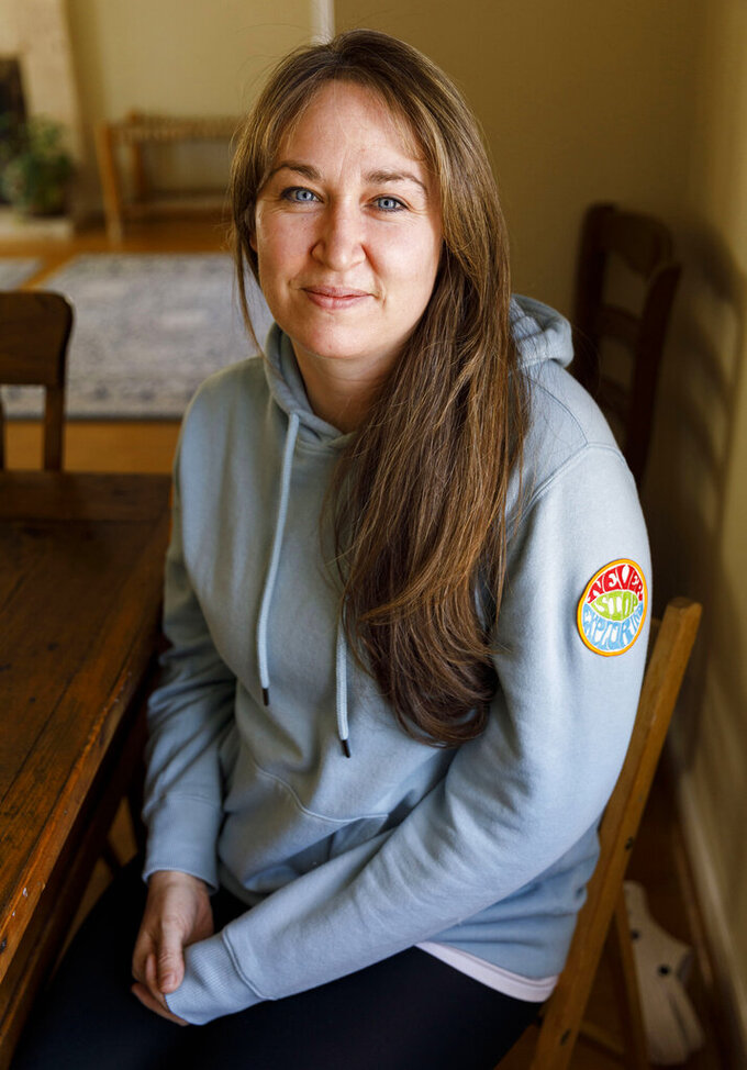 Jackie Fales, poses Friday, April 9, 2021, at her home in Cody, Wyo. Fales had to adjust her addiction recovery plan when the coronavirus pandemic hit last spring. (Lauren Modler/The Cody Enterprise via AP)