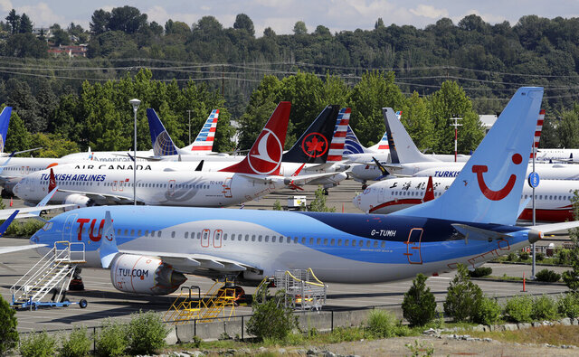 """FILE - This Aug. 15, 2019, file photo shows dozens of grounded Boeing 737 Max airplanes crowd a parking area adjacent to Boeing Field in Seattle. A congressional committee says a """"culture of concealment"""" at Boeing and poor oversight by federal regulators contributed to two deadly crashes involving the 737 Max jetliner. The House Transportation Committee issued a summary Friday, March 6, 2020, of its investigation so far into Boeing and the Federal Aviation Administration. (AP Photo/Elaine Thompson, File)"""