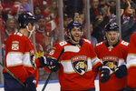 Florida Panthers left wing Mike Hoffman (68) celebrates with teammates and fans after scoring during the second period of an NHL hockey game against the Vancouver Canucks, Thursday, Jan. 9, 2020, in Sunrise, Fla. (AP Photo/Brynn Anderson)