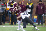 Minnesota wide receiver Demetrius Douglas holds onto the ball against Northwestern's Joe Bergin during an NCAA college football game Saturday, Nov. 17, 2018, in Minneapolis. (AP Photo/Stacy Bengs)