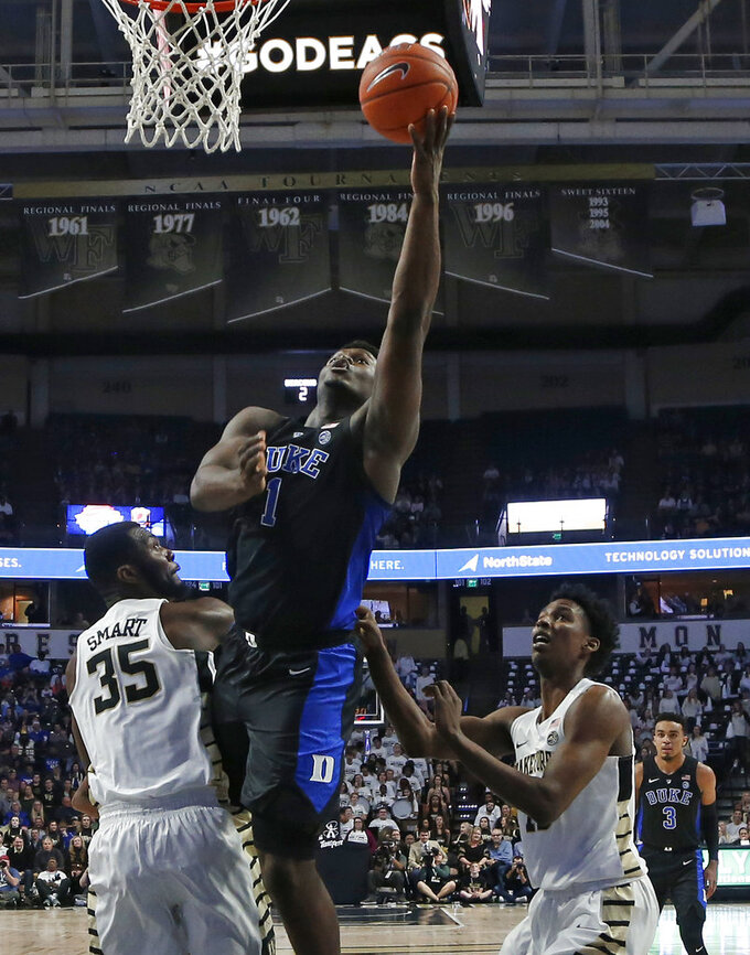 Duke's Zion Williamson (1) drives between Wake Forest's Ikenna Smart (35) and Jaylen Hoard during the first half of an NCAA college basketball game in Winston-Salem, N.C., Tuesday, Jan. 8, 2019. (AP Photo/Chuck Burton)
