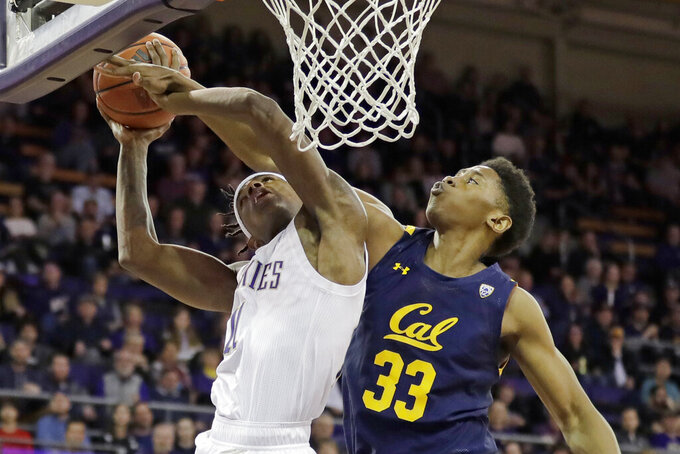 Washington guard Nahziah Carter, left, competes for a rebound against California forward D.J. Thorpe, right, during the second half of an NCAA college basketball game Saturday, Feb. 22, 2020, in Seattle. Washington won 87-52. (AP Photo/Ted S. Warren)