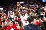 Rutgers' Shaq Carter (13) celebrates with fans after Rutgers defeated Maryland in an NCAA college basketball game Tuesday, March 3, 2020, in Piscataway, N.J. (AP Photo/John Minchillo)
