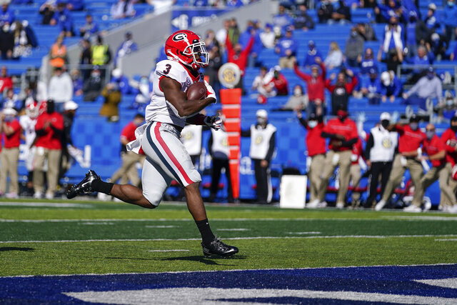 Georgia running back Zamir White (3) scores a touchdown during the second half of an NCAA college football game against Kentucky, Oct. 31, 2020, in Lexington, Ky. (AP Photo/Bryan Woolston)