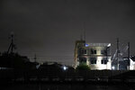 This Friday, July 19, 2019 photo shows the Kyoto Animation building that was destroyed in an arson attack in Kyoto, Japan.   A man screaming