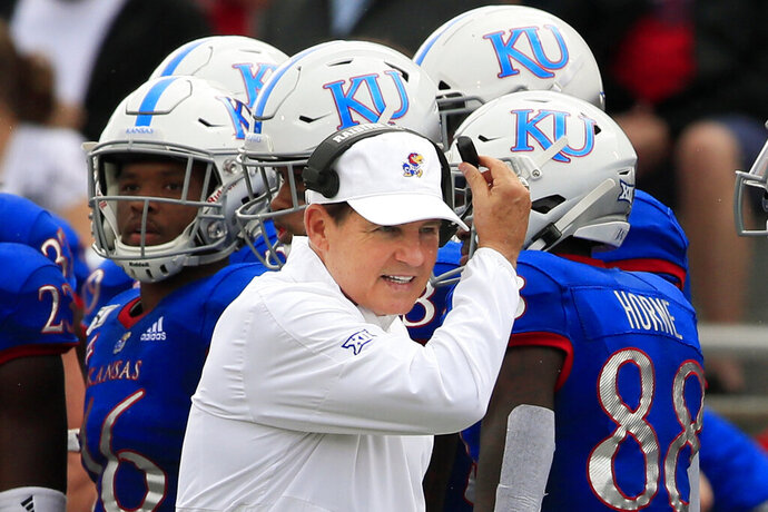 FILE - Kansas head coach Les Miles works the sidelines during the first half of an NCAA college football game against West Virginia in Lawrence, Kan., Saturday, Sept. 21, 2019. Coastal Carolina will visit the Jayhawks on Saturday night, Sept. 21, 2020, in the season opener for both teams. It's the lone non-conference game for Kansas, which will have a week off before visiting Baylor to open its nine-game Big 12 slate — on the date that Coastal Carolina was originally supposed to face the Jayhawks at home. (AP Photo/Orlin Wagner, File)