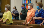 Parishioners wear face masks as they attend an in-person Mass at Christ the King Catholic Church in San Antonio, Tuesday, May 19, 2020. San Antonio parishes that have been closed due to the COVID-19 pandemic have began opening their doors to in-person services. (AP Photo/Eric Gay)