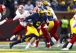 Michigan quarterback Shea Patterson (2) runs against Indiana in the first half of an NCAA college football game in Ann Arbor, Mich., Saturday, Nov. 17, 2018. (AP Photo/Paul Sancya)