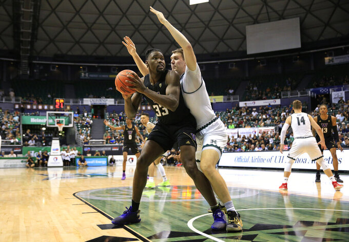 Hawaii center Dawson Carper guards Washington forward Isaiah Stewart (33) during the second half of an NCAA college basketball game Monday, Dec. 23, 2019, in Honolulu. (AP Photo/Marco Garcia)