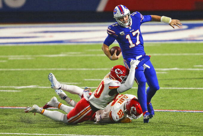 Kansas City Chiefs' Willie Gay (50) and Frank Clark (55) take down Buffalo Bills quarterback Josh Allen (17) during the second half of an NFL football game, Monday, Oct. 19, 2020, in Orchard Park, N.Y. The Chiefs defeated the Bills 26-17. (AP Photo/Jeffrey T. Barnes)