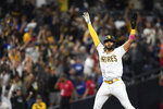 San Diego Padres' Fernando Tatis Jr. (23) celebrates after Jake Cronenworth (9) hit a two-run home run during the fifth inning of a baseball game against the Los Angeles Dodgers, Monday, June 21, 2021, in San Diego. (AP Photo/Denis Poroy)