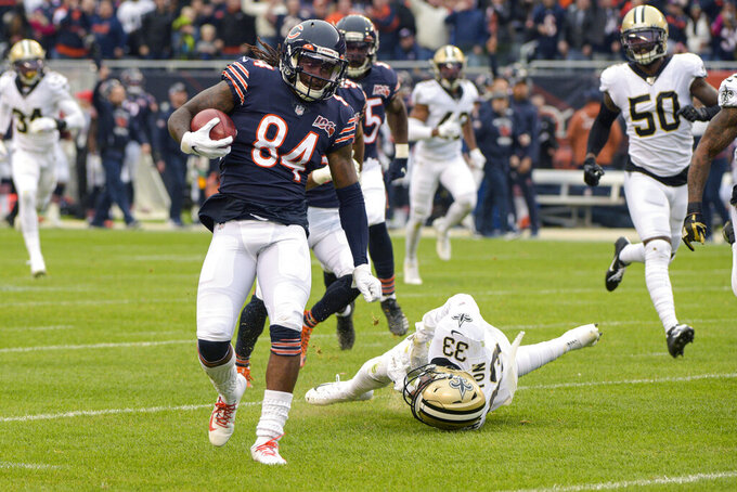 Chicago Bears wide receiver Cordarrelle Patterson (84) heads to the end zone for a touchdown after getting past New Orleans Saints' Saquan Hampton (33) on a kickoff return during the first half of an NFL football game in Chicago, Sunday, Oct. 20, 2019. (AP Photo/Mark Black)