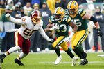 Green Bay Packers' Aaron Jones runs during the second half of an NFL football game against the Washington Redskins Sunday, Dec. 8, 2019, in Green Bay, Wis. (AP Photo/Matt Ludtke)