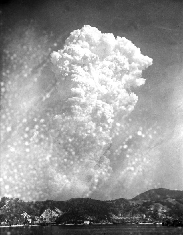 FILE - In this Aug. 6, 1945, file photo, smoke rises 20,000 feet above Hiroshima, western Japan, after the first atomic bomb was dropped during warfare. Hiroshima was targeted because it was a major Japanese military hub filled with military bases and ammunition facilities. The city of Hiroshima on Thursday, Aug. 6, 2020 marks the 75th anniversary of the world's first nuclear attack. (AP Photo, File)