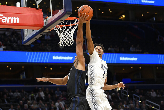 Georgetown forward Jamorko Pickett (1) blocks Butler forward Bryce Nze, left, during the first half of an NCAA college basketball game, Tuesday, Jan. 28, 2020, in Washington. (AP Photo/Nick Wass)