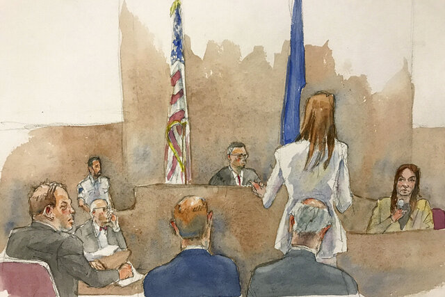 In this courtroom sketch, defendant Harvey Weinstein, far left, listens, as Assistant District Attorney Megan Hast, standing before the bench second from right, gestures while witness Mimi Haleyi, far right, holds a microphone during Haleyi's testimony in Weinstein's sexual misconduct and rape trial, Monday, Jan. 27, 2019, in Manhattan Supreme Court in New York. Supreme Court Judge James Burke, above, is shown seated between two flags. Haleyi testified Monday that weeks after arriving in New York to work for one of his shows, she found herself fighting in vain as the once-revered showbiz honcho pushed her onto a bed and sexually assaulted her, undeterred by her kicks and pleas of,