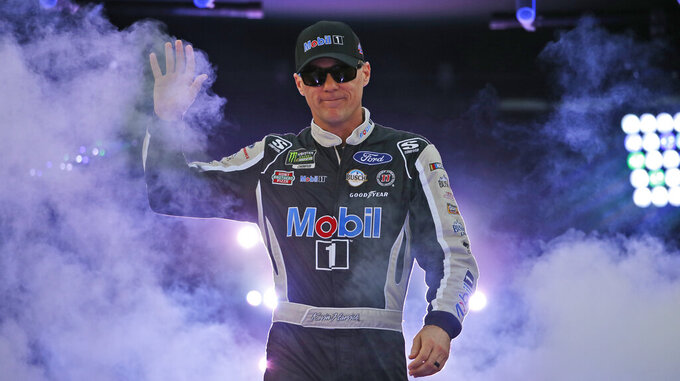 Kevin Harvick greets fans during driver introductions for the NASCAR Monster Energy Cup series auto race at Richmond Raceway in Richmond, Va., Saturday, Sept. 21, 2019. (AP Photo/Steve Helber)