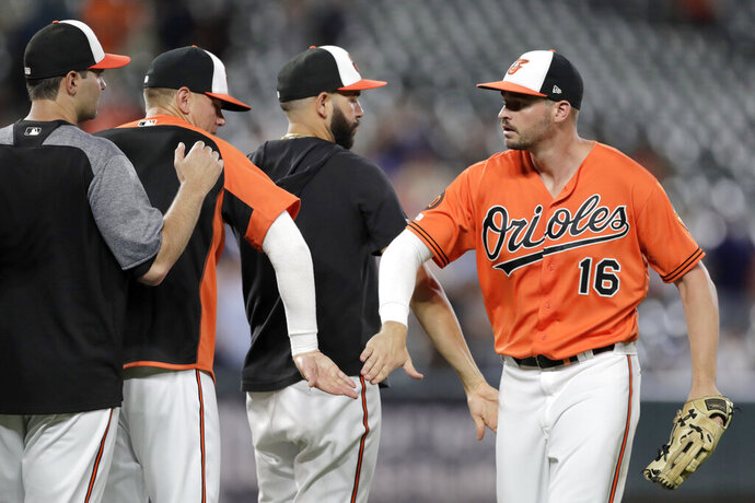 Baltimore Orioles right fielder Trey Mancini (16) celebrates with teammates after defeating the Toronto Blue Jays in a baseball game, Saturday, Aug. 3, 2019, in Baltimore. (AP Photo/Julio Cortez)
