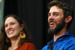 Travis Kauffman responds to questions during a news conference Thursday, Feb. 14, 2019, in Fort Collins, Colo., about his encounter with a mountain lion while running a trail just west of Fort Collins last week. Kaufman's girlfriend, Annie Bierbower, looks on. (AP Photo/David Zalubowski)