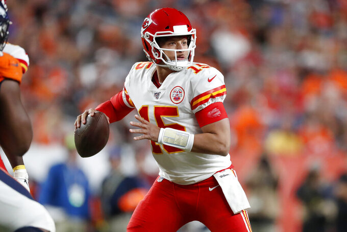 Kansas City Chiefs quarterback Patrick Mahomes (15) throws against the Denver Broncos during the first half of an NFL football game, Thursday, Oct. 17, 2019, in Denver. (AP Photo/David Zalubowski)