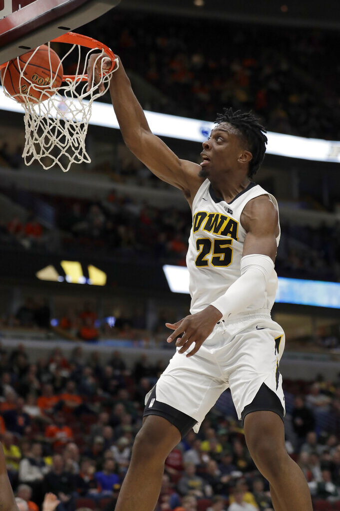 Iowa's Tyler Cook (25) dunks during the second half of an NCAA college basketball game against the Illinois in the second round of the Big Ten Conference tournament, Thursday, March 14, 2019, in Chicago. (AP Photo/Nam Y. Huh)