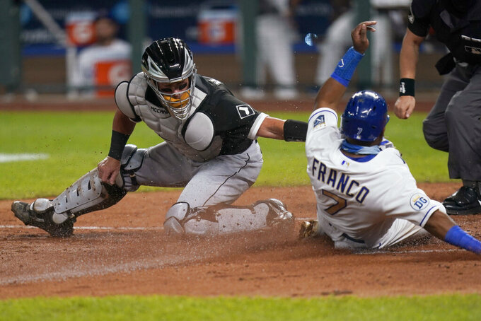 FILE - In this Sept. 4, 2020, file photo, Chicago White Sox catcher James McCann, left, misses the tag on Kansas City Royals' Maikel Franco (7), who scores during the fourth inning of a baseball game in Kansas City, Mo. Free agent catcher James McCann and the New York Mets were close to completing a $40 million, four-year contract Saturday, Dec. 12, 2020, as the team continues to upgrade its roster under new owner Steve Cohen. A person close to the deal confirmed the details to The Associated Press under condition of anonymity because there was no official announcement. (AP Photo/Orlin Wagner, File)