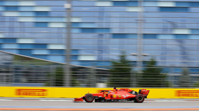 Ferrari driver Sebastian Vettel of Germany steers his car during the second free practice at the 'Sochi Autodrom' Formula One circuit, in Sochi, Russia, Friday, Sept. 27, 2019. The Formula one race will be held on Sunday. (AP Photo/Luca Bruno)