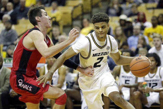 Missouri's Tray Jackson (2) heads to the basket past Incarnate Word's Vincent Miszkiewicz during the second half of an NCAA college basketball game Wednesday, Nov. 6, 2019, in Columbia, Mo. (AP Photo/Jeff Roberson)