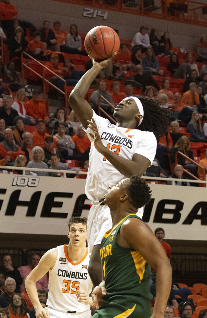 Oklahoma State forward Hidde Roessink (35) and Baylor guard Mark Vital (11) watch as Oklahoma State guard Isaac Likekele (13) takes a shot at the basket during an NCAA college basketball game in Stillwater, Okla., Saturday, Jan. 18, 2020. (AP Photo/Brody Schmidt)